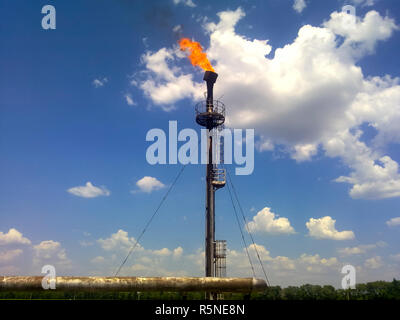 Flare for flaring associated gas. The end point of the pressure relief system on the oil facility. - Stock Photo