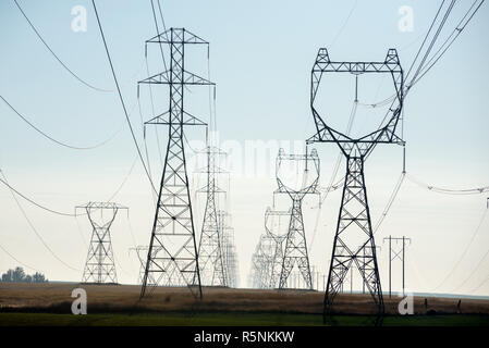High tension power lines in Eastern Washington. - Stock Photo