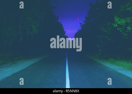 Night Road Vanishes in Background - Stock Photo