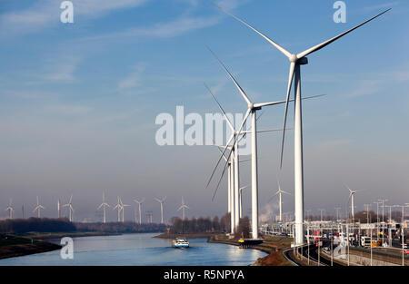 Wind turbines near canal in Rotterdam - Stock Photo