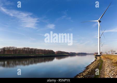 Wind turbines near canal Hartel in Rotterdam - Stock Photo