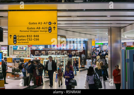 September 24, 2017 London/UK - People walking through and shopping at the duty free at Terminal 5, Heathrow Airport - Stock Photo