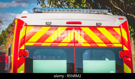 flashing light on a red ambulance firefighters - Stock Photo
