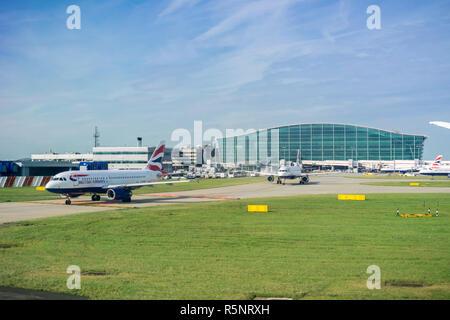 September 24, 2017 London/UK - British Airways airplanes leaving Terminal 5, Heathrow Airport - Stock Photo