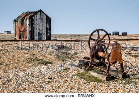 Old shack and rusty machinery on Dungeness beach - Stock Photo