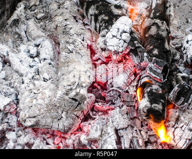 Smoldering coals in the grill. Burning fire after a shish kebab. - Stock Photo