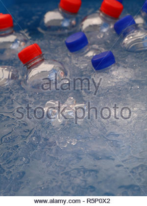PET plastic bottles of cold drinking water in ice - Stock Photo
