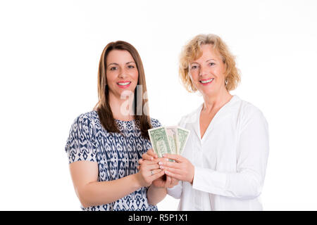 young woman and her mother with money - Stock Photo