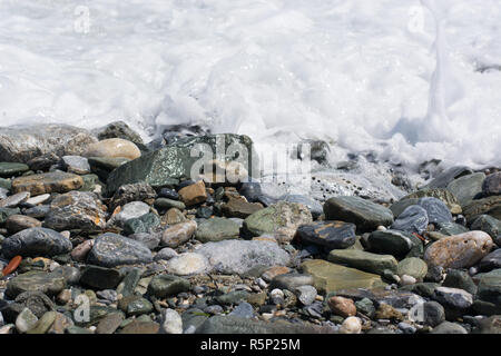 Wet pebble stones on the beach close up - Stock Photo