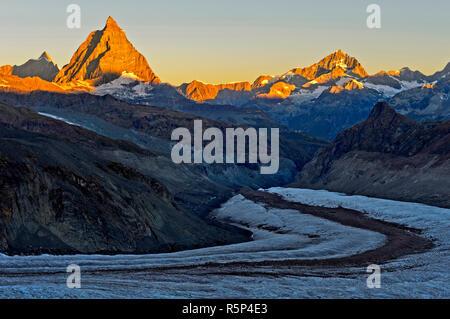 Morning sun at the Matterhorn, Dent d'Herens left, Dent Blanche right, Gorner glacier in front, Zermatt, Valais, Switzerland - Stock Photo