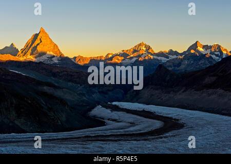 Morning sun at the Matterhorn, Dent d'Herens left, Dent Blanche, Ober Gabelhorn and Wellenkuppe right, Gorner glacier in front, Zermatt, Valais, Switz - Stock Photo