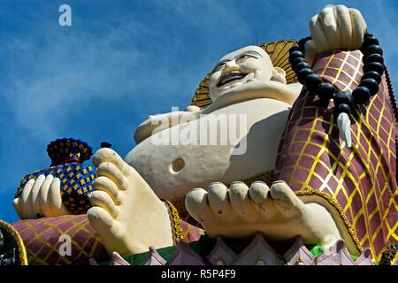 Laughing Buddha, Buddhist temple Wat Plai Laem, Koh Samui, Thailand - Stock Photo