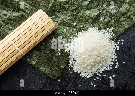 Green nori sheet , rice and bamboo mat. - Stock Photo