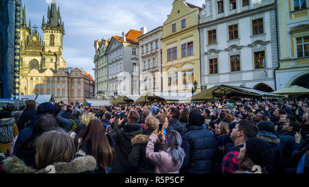 PRAGUE, CZECH REPUBLIC - DECEMBER 31, 2017 - Big crowd looking at the clock tower in Prague, Czechia. People taking pictures and videos when the clock - Stock Photo