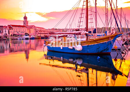 Historic island town of Krk golden dawn waterfront view - Stock Photo