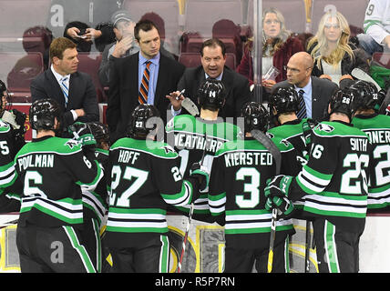 December 1, 2018 North Dakota coaches and players listen to head coach Brad Berry (second from right) during a time out of a NCAA men's ice hockey game between the University of North Dakota Fighting Hawks and the Minnesota Duluth Bulldogs at Amsoil Arena in Duluth, MN. Assistant coaches pictured Dane Jackson (left), Matt Smaby, Berry, and Matt Shaw (right), North Dakota won 2-1. Photo by Russell Hons/CSM - Stock Photo