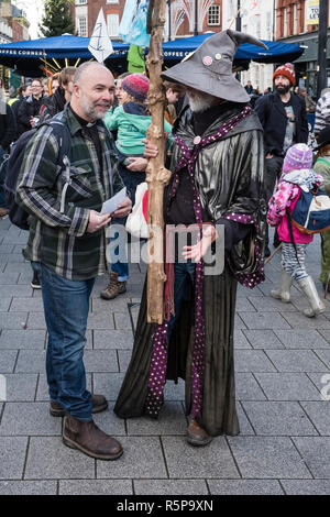 Hereford, UK. 1st December, 2018. Vicar Simon Lockett chats to climate activist Rick Guest (aka Gandalf) at a demonstration by the Extinction Rebellion movement in this old cathedral city . Credit: Alex Ramsay/Alamy Live News - Stock Photo