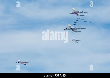 Emirates, Etihad, flydubai and Air Arabia perform a flypast with  on Sunday December 2, 2018, over the UAE with the Al Fursan aerobatic display team for National Day. Credit Elizabeth Coughlan/Alamy Live News. - Stock Photo