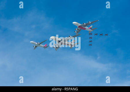 Emirates, Etihad, and Air Arabia perform a flypast with  on Sunday December 2, 2018, over the UAE with the Al Fursan aerobatic display team for National Day. Credit Elizabeth Coughlan/Alamy Live News. - Stock Photo
