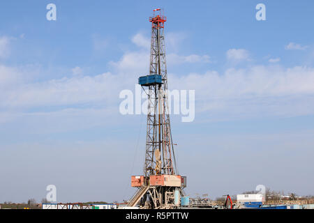Land oil drilling rig gas extraction mining industry - Stock Photo