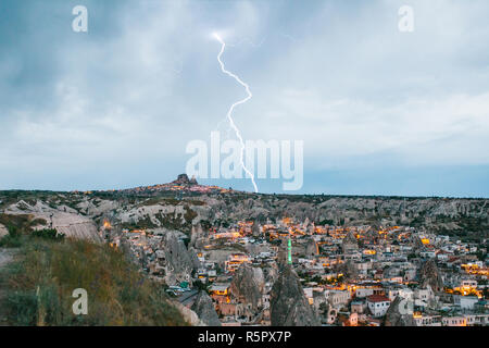 Lightning above the town of Goreme in Cappadocia in Turkey. Beautiful view of the city. - Stock Photo