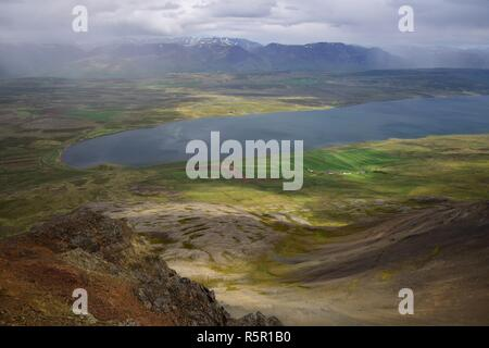 Icelandic landscape. View from the top of the Svinadalsfjall to the lake Svinavatn. In front is a mountain slide to be seen from above. Cloudy with so - Stock Photo