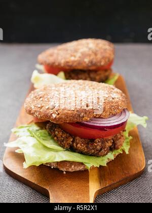 Lentil, Walnut Burgers on Whole Wheat Buns. - Stock Photo