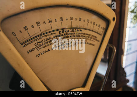 Vintage golden weighing scales as a part of restautant interior - Stock Photo