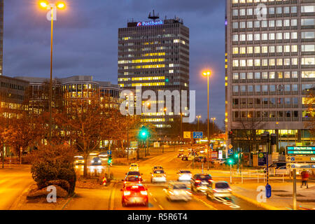 Evening city traffic in Essen, Germany, large intersection, Bismarck Square,  this area would also be affected by a diesel driving ban, - Stock Photo