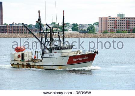 New Bedford, Massachusetts, USA - June 22, 2007: Fishing vessel approaching New Bedford's inner harbor - Stock Photo