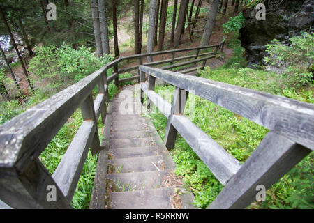 fastened walkway made of wood in wild nature without persons in the styria in the day - Stock Photo