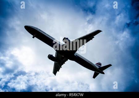 Under carriage of British Airways plane landing - Stock Photo