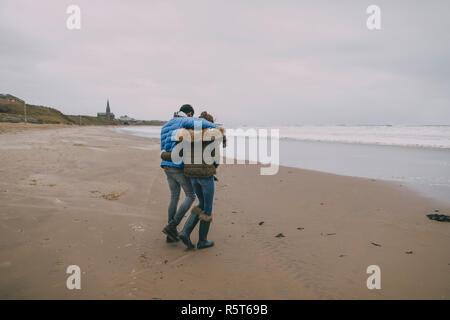Romantic Stroll On A Winter Beach - Stock Photo