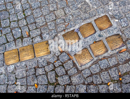 Berlin,Mitte. Stolpersteine, Stumbling block memorials in pavement remember victims of the Nazis who lived at 19 Almstadtstasse - Stock Photo