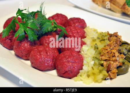 Beef tartare with pickled cucumber, marinated mushrooms and fresh onion on plate. - Stock Photo