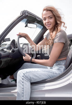 close up.stylish young woman sitting in a luxury car - Stock Photo