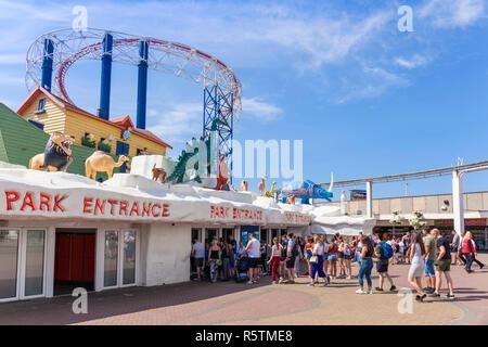 Blackpool uk Lots of people queueing to enter the Blackpool pleasure beach amusement park fairground Blackpool Lancashire England UK GB Europe - Stock Photo