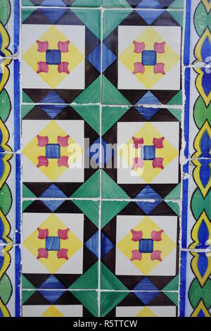 Lisbon / Portugal - May 2017: Portuguese traditional painted tin-glazed ceramic tiles Azulejos decorated with blue, black, green and yellow squares an - Stock Photo