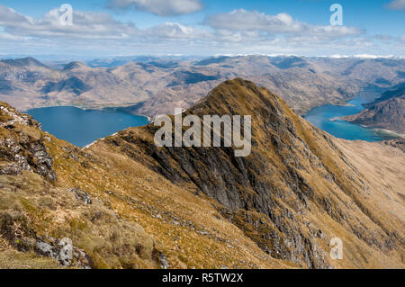 Loch Hourn and the snow-capped mountains of Glenshiel from Ladhar Bheinn, Scotland - Stock Photo