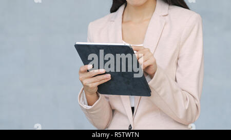 Business woman working on digital tablet computer - Stock Photo