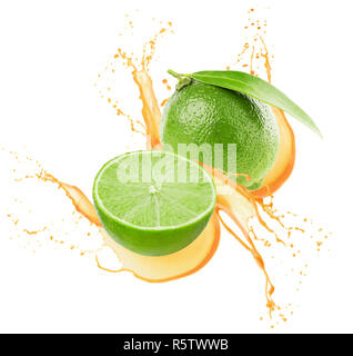 limes in juice splash isolated on a white background. - Stock Photo