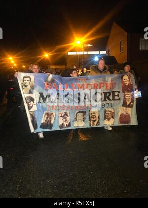 Family members and friends of those who lost their lives during the Ballymurphy shootings in the west of Belfast in 1971 hold a candlelight vigil in their memory. - Stock Photo