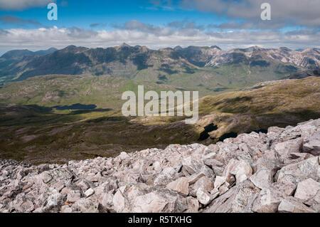 Torridon giants (Beinn Allgin, Liathach, Beinn Eighe) from, Beinn Liath Mhor, Scotland - Stock Photo