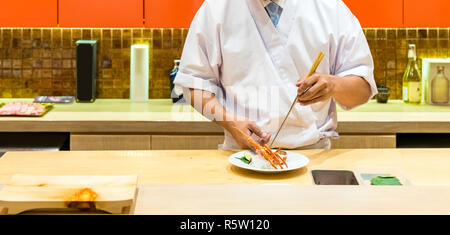 chef cooking lobster sashimi - Stock Photo