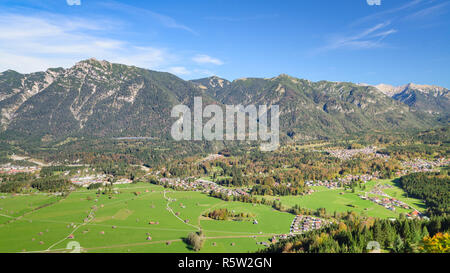 Aerial landscape with green meadow in Alpine valley - Stock Photo