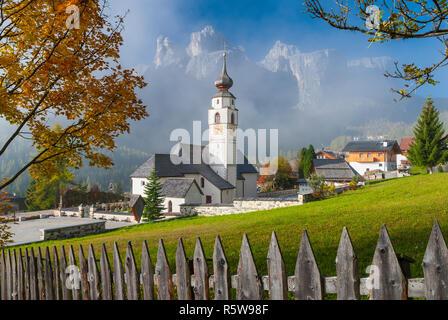 Parish Church St. Vigilius in Colfosco, Dolomites, Italy - Stock Photo