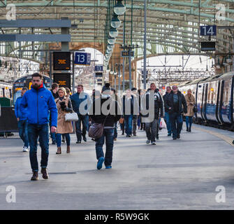 passengers leaving a Scotrail train at Glasgow central railway station - Stock Photo