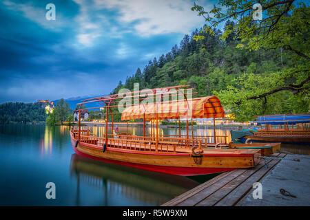 Traditional pletna boats on Lake Bled, Slovenia - Stock Photo