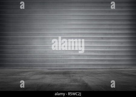 Metal roller shutter texture with concrete floor - Stock Photo