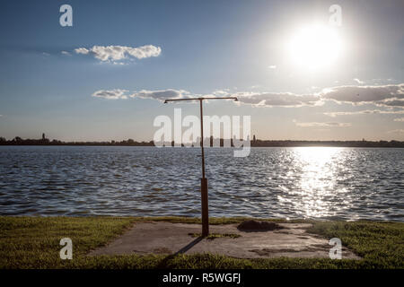 Rusty shower on a beach facing the Blue water of Palic Lake, in Subotica, Serbia, during a summer sunset Also known as Palicko Jezero, it is one of th - Stock Photo